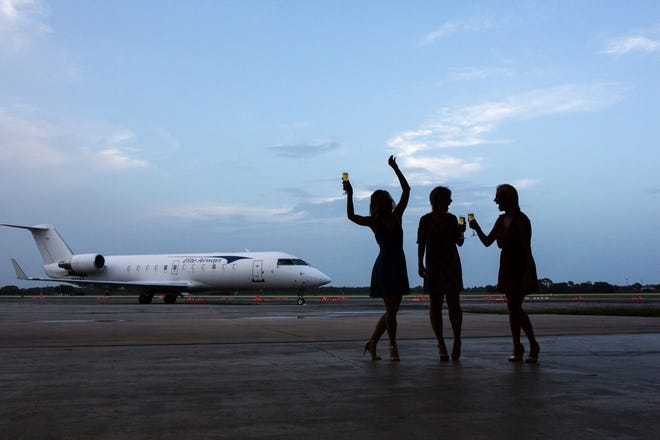 Partygoers enjoy the 2018 Wine Women & Shoes at Sun Jet Aviation's hangar at the Vero Beach Regional Airport. The 2019 party promises to be the best night ever.