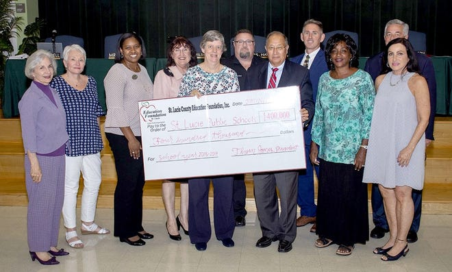 The St. Lucie County Education Foundation recentlypresented the St. Lucie County School Board with$400,000. Pictured are, from left, Elizabeth Mallonee, Robbi Giaccone, Shrita Walker, Kathryn Hensley, Debbie Hawley, David Freeland, Thom Jones, Troy Ingersoll, Dr, Donna Mills, E. Wayne Gent and Carol Hilson.