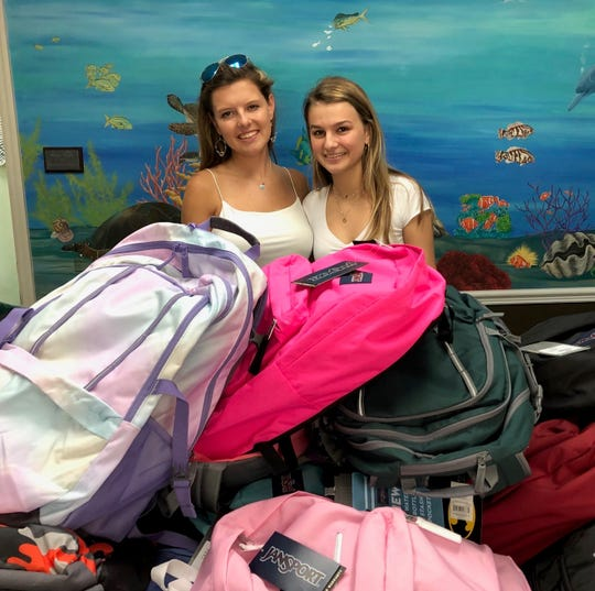 Ashby Taylor, left, and Michaela Miller recently delivered 40 backpacks filled with school supplies to the Hibiscus Children's Village in Vero Beach.