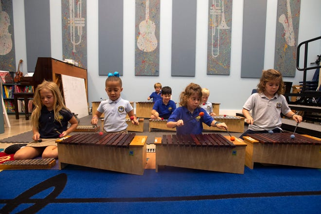 The Pine School first graders Gracelyn Dickinson (from left), Stella Williams, Gaston Even and Marcelo Even play xylophones in a music class Wednesday, Sept. 18, 2019, at the school in Hobe Sound. Band and music classes are currently held in small rooms meant to be athletic storage spaces, but a 24,000 square foot arts and athletics building will provide new performing arts classrooms, a stage and more. The school is celebrating its 50th year anniversary this year.