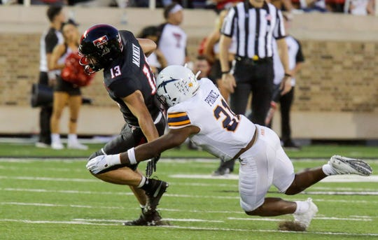 Justin Prince tackles Texas Tech receiver  McLane Mannix Sept. 7 at Jones Stadium in Lubbock.