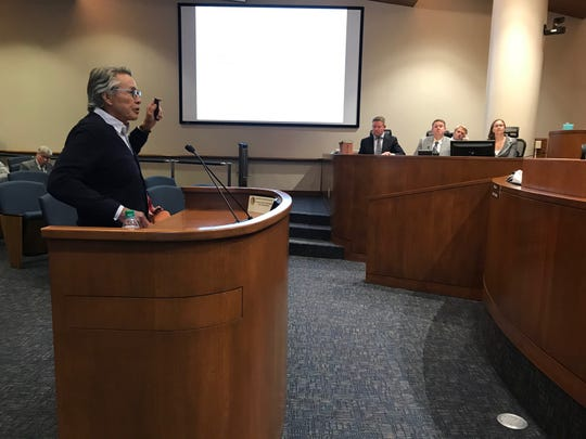 Winery owner Andrew Holguin argued his case before the Ventura County Board of Supervisors Tuesday. County planning officials Winston Wright, Dave Ward and Franca Rosengren listen at right along with county attorney  Jeff Barnes behind them.