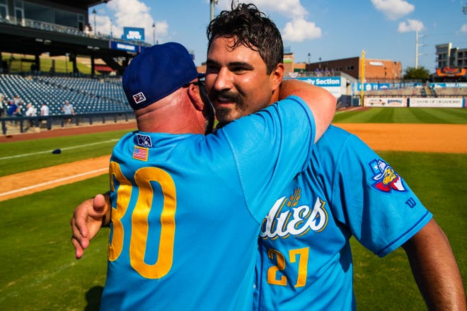 Oaks Christian graduate Travis Radke, right, celebrates the Texas League championship with Amarillo Sod Poodles manager Phillip Wellman. Radke closed out Amarillo's Game 5 win over host Tulsa at OneOK Field on Sunday.