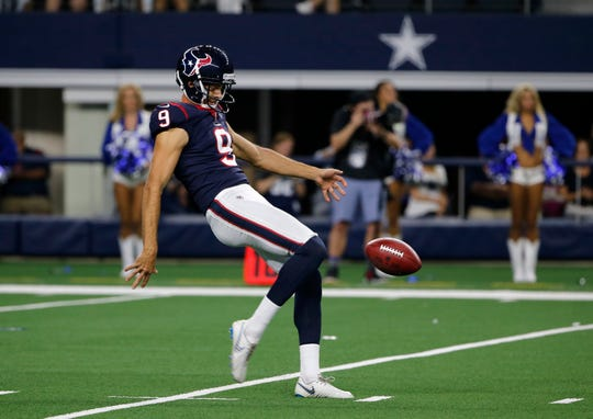 Bryan Anger hits a punt during a Texans' preseason game against the Cowboys on Aug. 24. The Camarillo High graduate is back with the Texans after being cut at the end of the preseason.