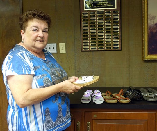 "Norene Ritter, past president of the Woman's Club of Vineland, is leading a project to collect shoes for ""Soles 4 Souls."""
