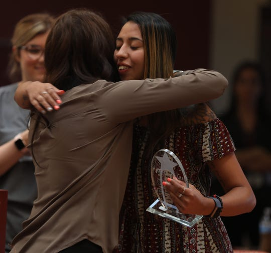 Destinee Vittone of Poughkeepsie accepts the Medal of Independence honor during the 119th Helen Hayes Hospital Honors Assembly in Stony Point Sept.17, 2019. The Honors Assembly began in 1900 as a school graduation ceremony for children at the then-pediatric rehabilitation facility. Now it celebrates the patients' resolve and support of others in similar situations.