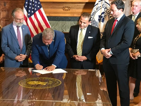Mayor Mike Spano signing legislation that bans flavored e-cigarettes in the city. Sept. 18, 2019