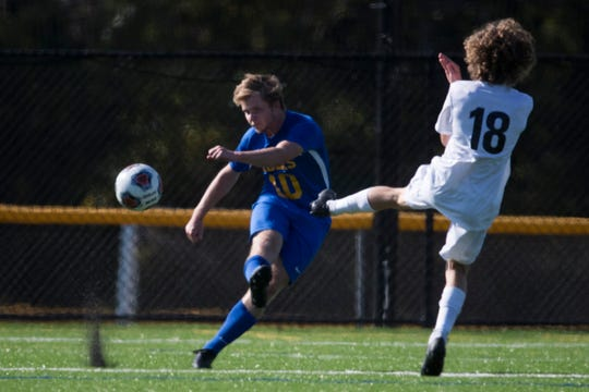 Caesar Rodney's Spencer Ott (10) clears the ball past Appoquinimink's Marcos Repolle (18) during their Sept. 17 matchup at CR. Appoquinimink won 2-0.
