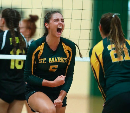 St. Mark's Savannah Seemans shares a celebration with teammates in St. Mark's 3-0 sweep of Padua Tuesday at St. Mark's High School.