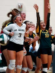 The St. Mark's bench, including libero Alyssa Berggrun (3), celebrates a point in the first set of St. Mark's 3-0 sweep of Padua last Tuesday at St. Mark's High School.