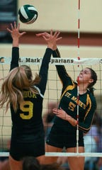 St. Mark's Savannah Seemans tries to hit past Padua's Jaqueline Barnett in St. Mark's 3-0 sweep of Padua Tuesday at St. Mark's High School.