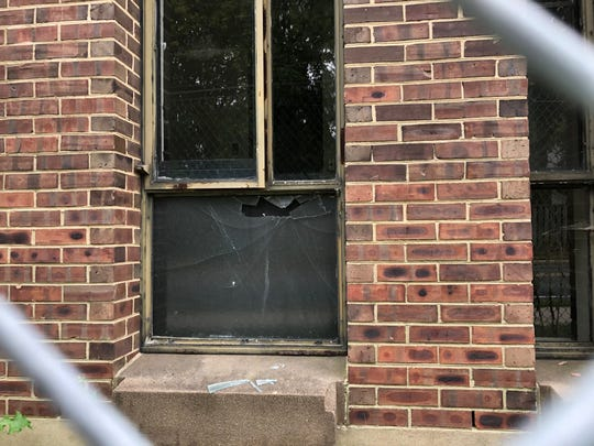Shattered windows are a common site at the Rodney dorm complex along Hillside Road. The complex is being demolished this fall.