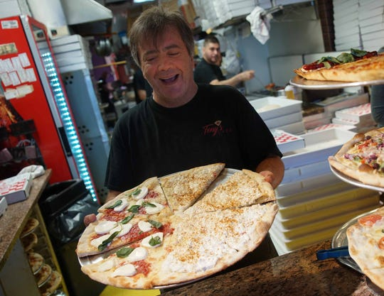 """Tony's Cafe in Newark is was voted No. 4 out of 16 for best pizza in Delaware. The most popular? """"There's too many to name,"""" owner Luigi Illiano says, but concedes that the """"grandmom"""" is probably the biggest seller. Customers also like Tony's crab pizza."""