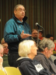 """Former Wisconsin Rapids Mayor Vernon """"Bud"""" Verjinsky speaks during a town hall meeting at McMillan Memorial Library in this 2011 file photo."""
