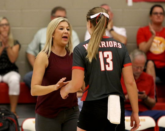 Christ Academy head volleyball coach Sara Lindemann talks to Kelsey Wilson in the match against Notre Dame Tuesday, Sept. 17, 2019, at Christ Academy.