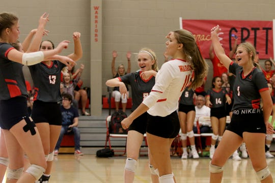 Christ Academy celebrates winning a point against Notre Dame Tuesday, Sept. 17, 2019, at Christ Academy.
