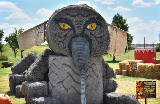 A large elephant built with painted hay bales is part of the circus-themed play area at Smith's Gardentown Farms Pumpkin Patch. Other attractions include a petting zoo, wagon rides and bounce houses.