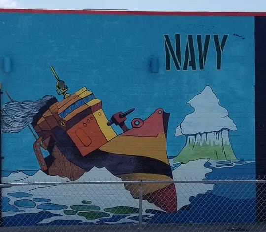 This part of the mural at The Deli Planet & Drinkery at 4014 Sheppard Access Road features the U.S. Navy.