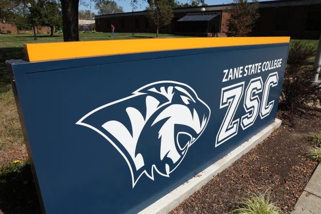 A student leaves College Hall on the Zane State College campus. The tiger logo was unveiled at the start of the college's anniversary celebration.