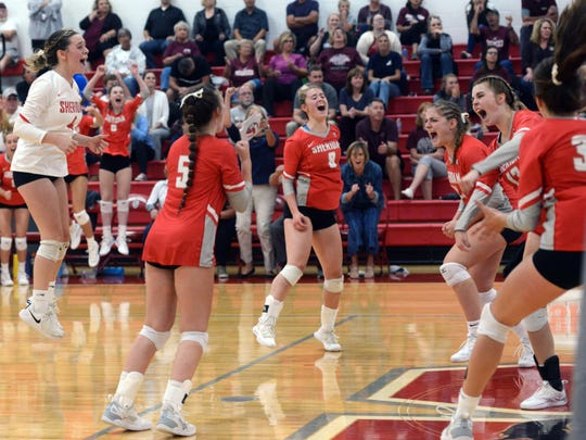 Sheridan players, from left, Julia Finck, Grace Conrad, Brooklyn Heller, Kendyl Mick, Erin Schultz and Ally Perkins celebrate the match-winning point against John Glenn on Thursday at Glen Hursey Gymnasium.