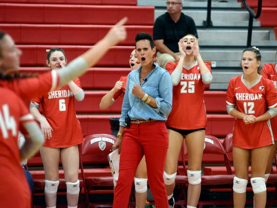 Sheridan coach Mandy Fox gives a fist pump after her team scored a point against John Glenn on Thursday at Glen Hursey Gymnasium. Fox was named the District 12 Division II coach of the year.