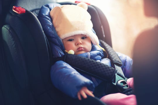 It is advised that children do not wear thick, heavy coats in a car seat, as it inhibits the straps ability to restrain and protect the child.