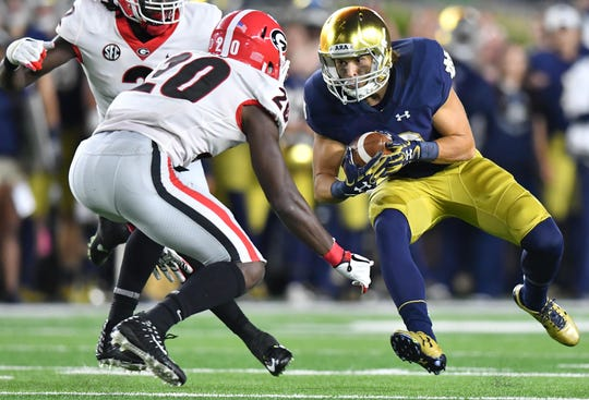 Notre Dame wide receiver Chris Finke carries the ball as Georgia safety J.R. Reed prepares to make a tackle during their game in 2017.