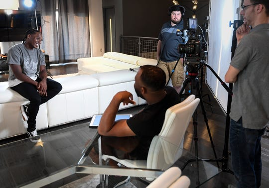 Tennessee Titans cornerback Adoree' Jackson laughs with the production crew as he films a promotional video for a reality TV show he will host at his home Friday, Sept. 13, 2019 in Nashville, Tenn.