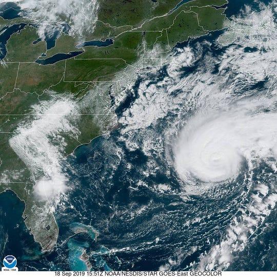 A satellite image taken Wednesday morning, Sept. 18, 2019, shows Hurricane Humberto (right) spinning in the Atlantic Ocean toward Bermuda.