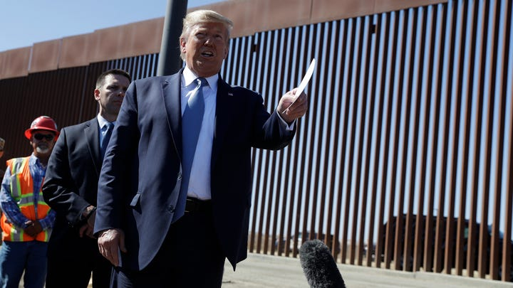 President Donald Trump talks with reporters as he tours a section of the southern border wall, Wednesday, Sept. 18, 2019, in Otay Mesa, Calif. (AP Photo/Evan Vucci) ORG XMIT: CAEV426
