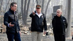 President Donald Trump talks with then Gov.-elect Gavin Newsom, left, as California Gov. Jerry Brown listens during a visit to a neighborhood impacted by the wildfires in Paradise, Calif. State Republicans have approved a rule change intended to ensure the party can send delegates to the GOP's national convention next summer, even if President Trump is kept off the state's 2020 primary ballot. The measure is a response to a law signed by Democratic Gov. Newsom in July that requires presidential candidates to release their tax returns, a move clearly aimed at the Republican president.