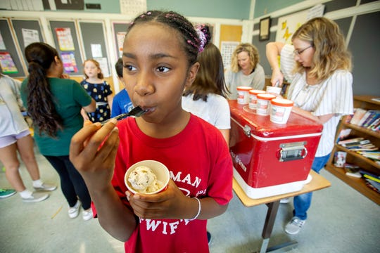 Shamiah Rivers, a 5th grader at Chapman Elementary School tries a new Salt & Straw ice cream flavor, I Oat You One, that was invented by two of her fellow students, Katharina and Izzy.