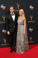 Thomas Middleditch and wife Mollie Gates on the red carpet at the 2016 Emmy Awards.