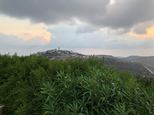 A view of a Palestinian village from the Israeli Jewish settlement Neve Tzuf, north of Ramallah, in the West Bank, on Sept. 9, 2019.