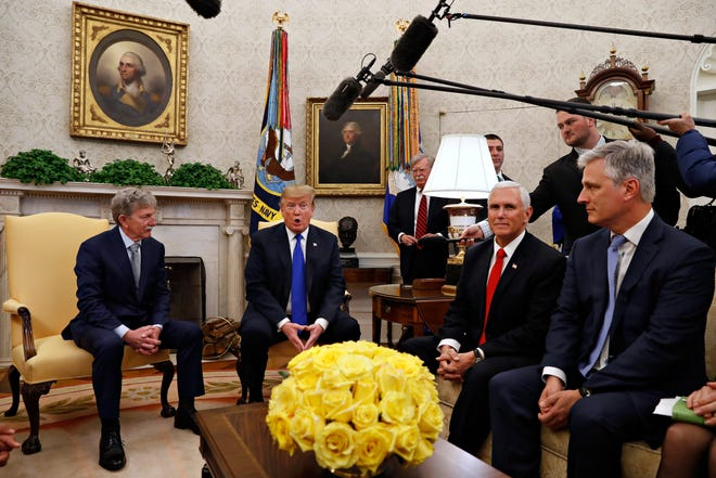 In this March 6, 2019, file photo, former U.S. hostage in Yemen, Danny Burch, left, listens as President Donald Trump speaks, Wednesday, March 6, 2019, in the Oval Office of the White House in Washington, next to Vice President Mike Pence, and Special Presidential Envoy for Hostage Affairs Robert O'Brien.