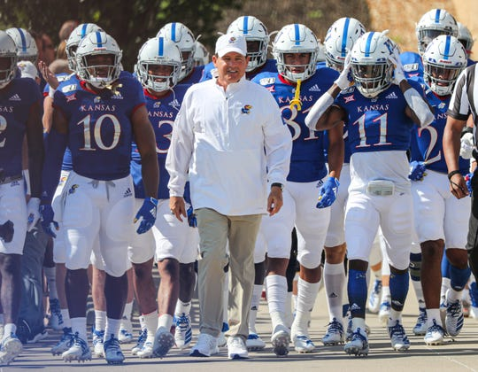 Kansas coach Les Miles leads his team onto the field before their game against Indiana State.