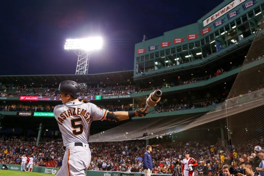 San Francisco Giants left fielder Mike Yastrzemski warms up before his first at-bat at Fenway Park.