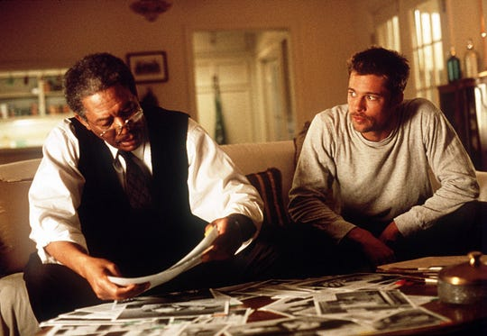 """Brad Pitt (right, with Morgan Freeman) now sees the 1995 thriller """"Seven"""" as a """"turning point"""" in his career."""