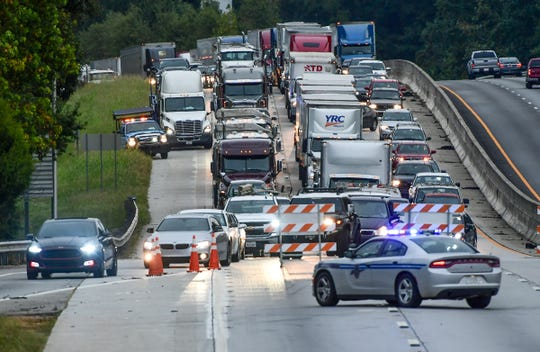A South Carolina Trooper makes a detour from exit 27 on Southbound I-85, ahead of where investigators were working a two 18-wheeler collision on I-85 Thursday, Sept. 19, 2019.
