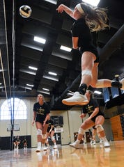 T.L. Hanna High senior middle hitter Hannah Hanson spikes a ball during practice Thursday, Sept. 19, 2019.