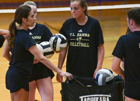 T.L. Hanna High coach Becky Easton, left, works with players during practice Thursday, Sept. 19, 2019.