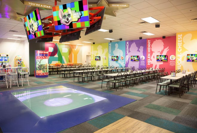 Chuck E. Cheese's new look includes bright colors and a light-up dance floor.