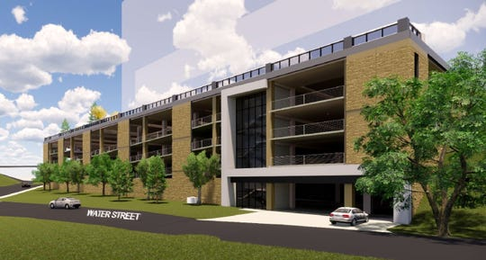 A rendering by Hoffman Planning, Design & Construction shows the south elevation of a four-level, 642-stall city parking ramp that would be built on Bluff Site 1 in downtown Appleton. U.S. Venture would construct its new headquarters on top of the ramp.