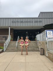 Katie Hamrah (left), a 14-year Rockette and Middlesex native, during a visit to the South Brunswick Library last year.