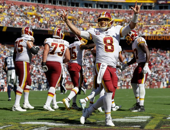 Washington Redskins quarterback Case Keenum (8) celebrates in the end zone after throwing a touchdown pass to wide receiver Paul Richardson in the second half against Dallas Cowboys, Sunday, Sept. 15, 2019, in Landover, Md.