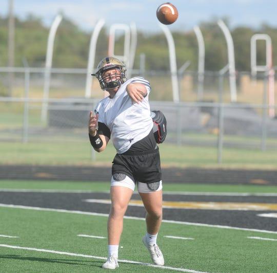 Clyde senior quarterback Dylan Neuman throws a pass during practice Tuesday at Bulldog Stadium.
