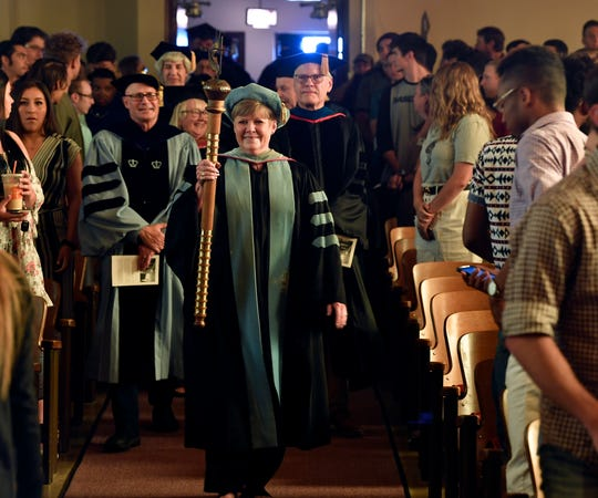 McMurry University Faculty Marshal Pug Parris leads the faculty into Radford Auditorium to begin convocation Thursday.
