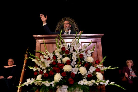 George Levesque makes an expansive gesture during his address at McMurry University's convocation Thursday at Radford Auditorium. Levesque is a 1996 McMurry graduate, a former television anchor, and now the executive director of the Paramount Theatre.