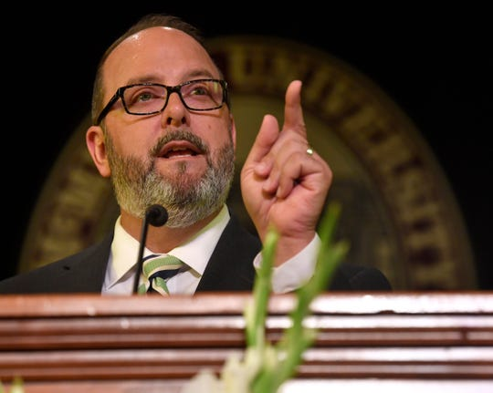 McMurry University alumnus George Levesque emphasizes his point as he delivers the school's convocation address Thursday.