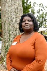 Libby Kyles, CEO of the YWCA, stands next to the remaining oak tree along Timothy Street on the organization's property September 19, 2019.